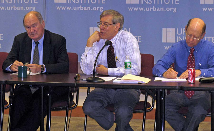 Urban Institute President, Robert Reischauer (center) speaks at the annual budget roundtable discussion in 2008.