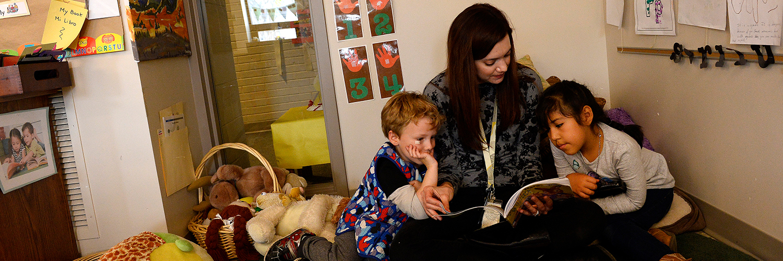 Teacher reading to two children
