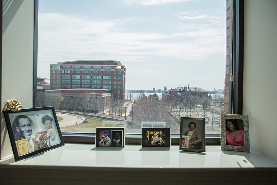 Photographs of Richardson's family and her late husband sit inside the windowsill of her apartment's living room, which overlooks the Detroit River.
