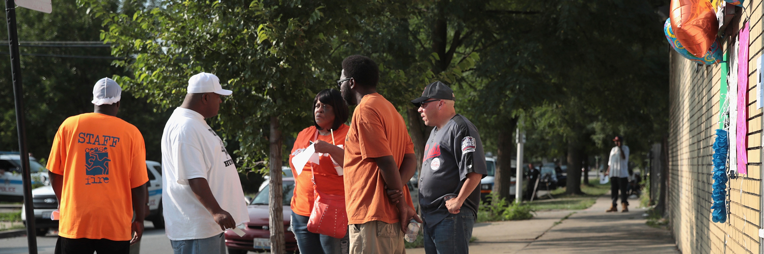 Community activists gather near a small memorial outside a liquor store on the city's south side where 58-year-old fellow activist Willie Cooper was shot and killed on July 17, 2017 in Chicago, Illinois.