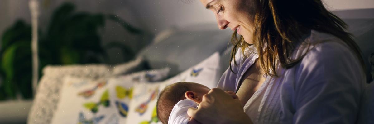 Mother nursing baby