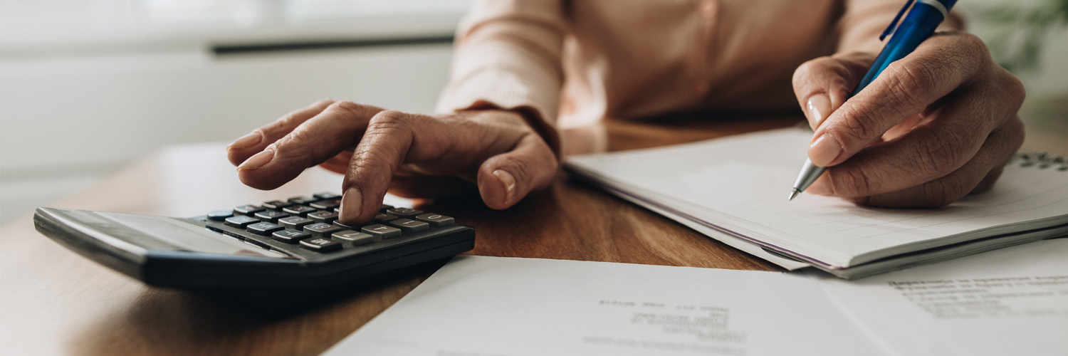 Older woman calculating expenses