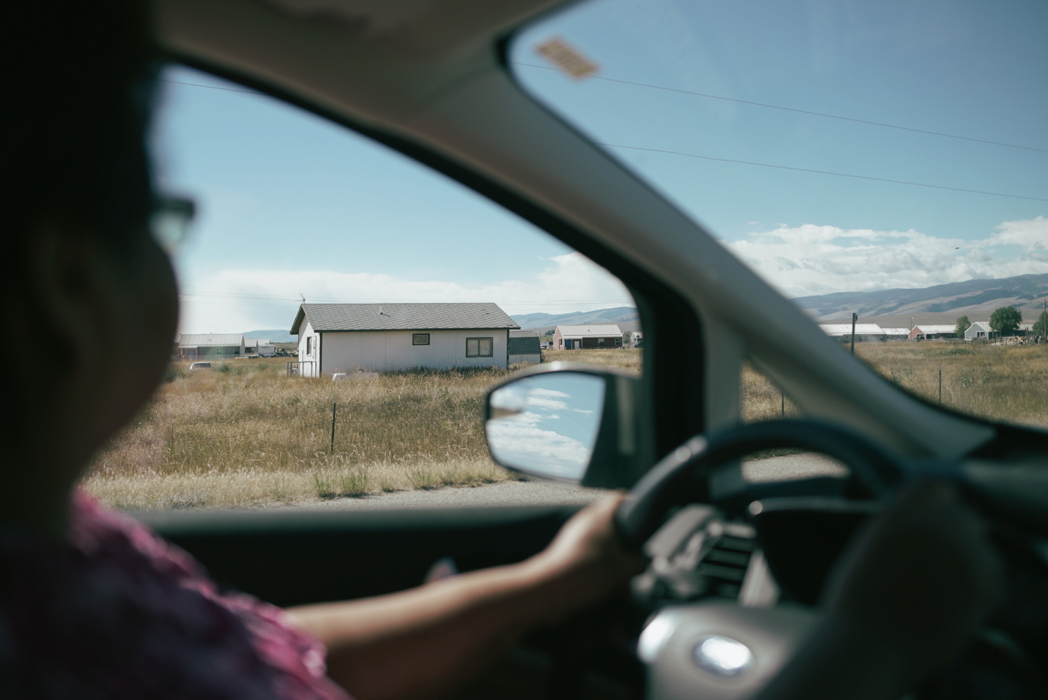 Elsie drives on the reservation, pointing out houses where she or her family members used to live. Because Elsie is from the community she serves, she's better able to empathize with the challenges faced by the parents she works with, according to her boss, Kim Clemetson, who directs Wind River's Family Spirit home visiting program.