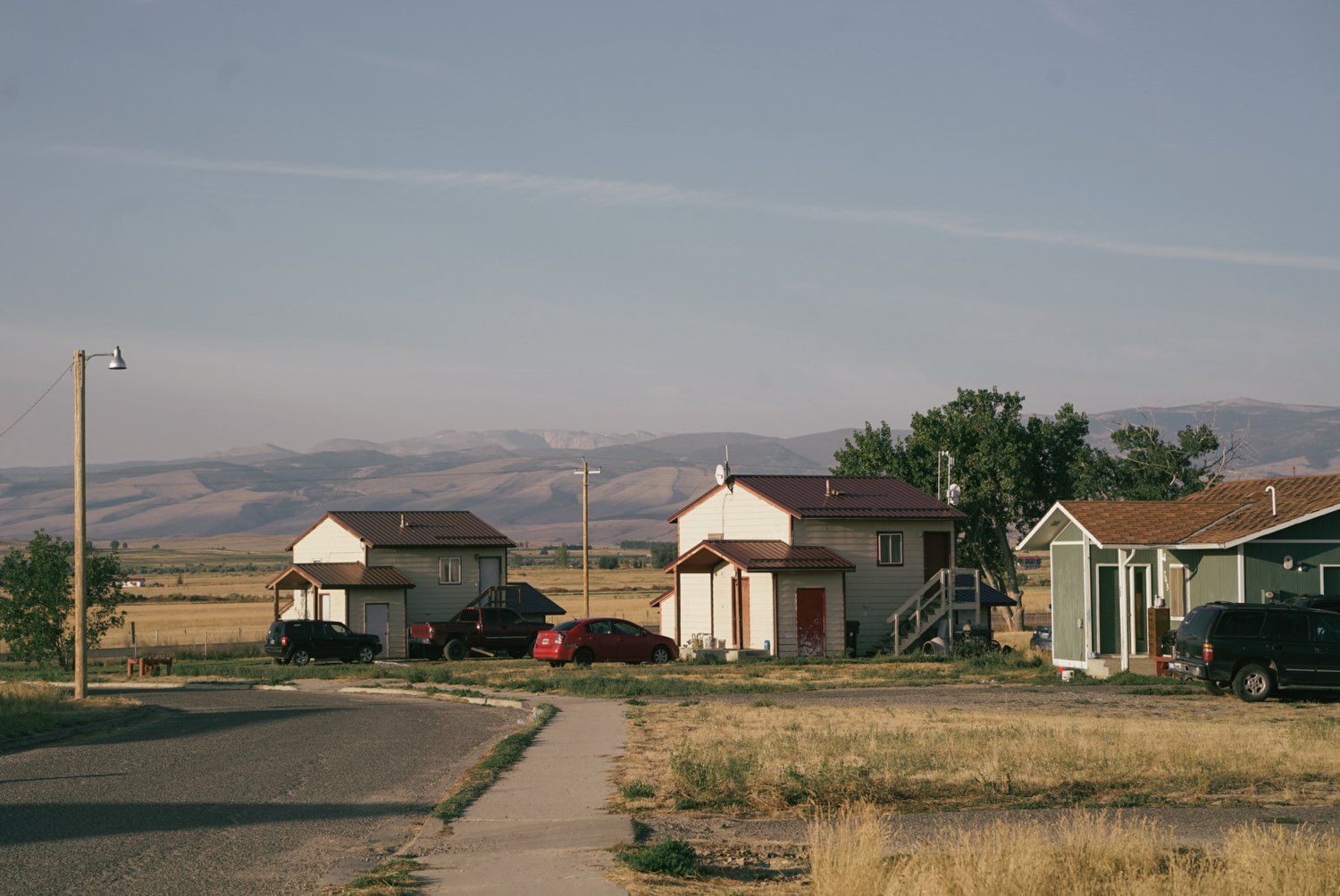 The sun rises over subsidized housing on the Wind River Indian Reservation.