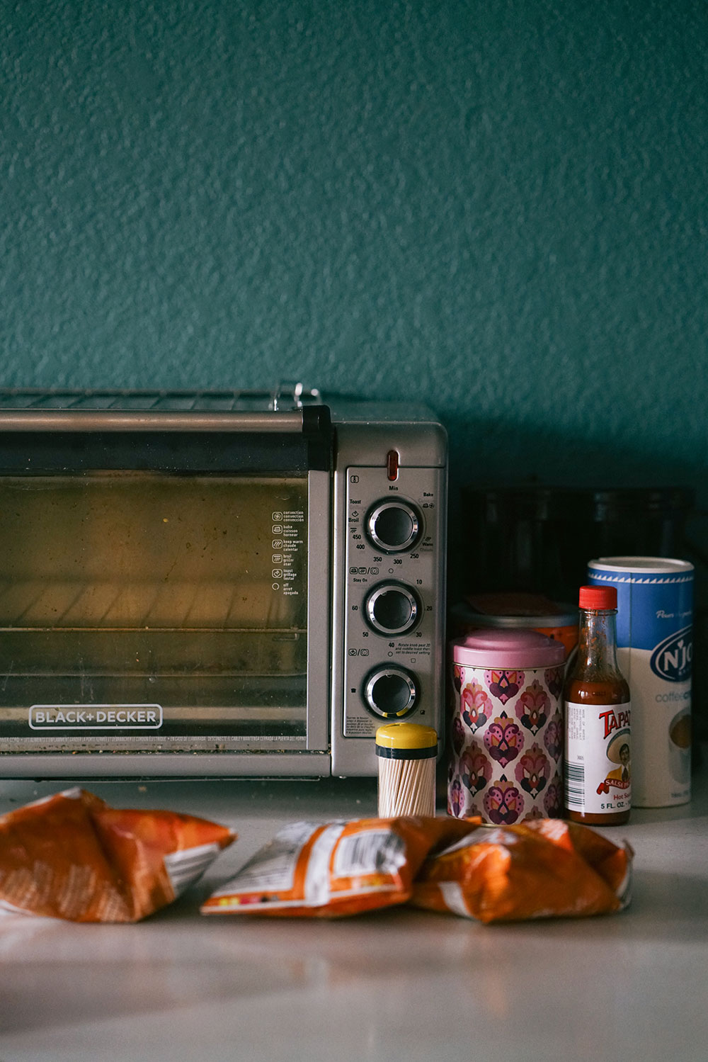 Malcolm likes to cook, and this toaster oven was one of the first things he bought for his new apartment.